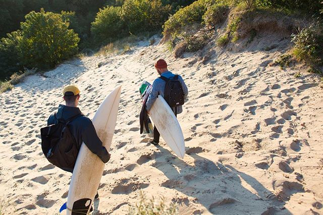 Heavy steps, descending in reach for liquid entertainment. Jackets to protect them self from the cold eastern wind. Two friends, a mission and all the time in the world. #surf #dunes #outdoor #surfing #hike #campvibes #mates #photography #spotsearch