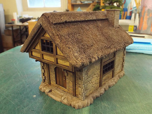 MDF cottage (by  LCA. Lasercut Architect ) with custom Styrofoam thatch