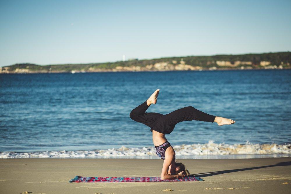 Yoga on the beach with best health coach