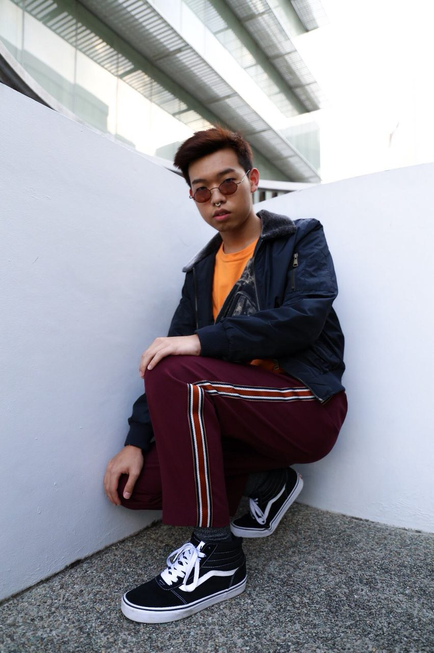 @kenjibasenji - Cop the Style:Graphic T-Shirt – TOPMAN, Orange MNHTNPants – ASOS, Design Tapered Trousers in Burgundy with Side Stripe TapeShoes – VANS, SK8-Hi SneakersSunnies – Reclaimed Vintage Round SunniesDescribe Your Style in 3 Words Androgynous, Funky & Statement-MakingStaple Item:Belt – It ties everything together. If you want to switch up, go for an eccentric type!What's in my bag?Bottled water, Lip Balm, Earpiece, Portable Charger Mints & the essentials! (wallet, phone etc)How to: Speed up Bag CheckBring a slim wallet that fits in your pocket! Don't go through the hassle of bringing too much.