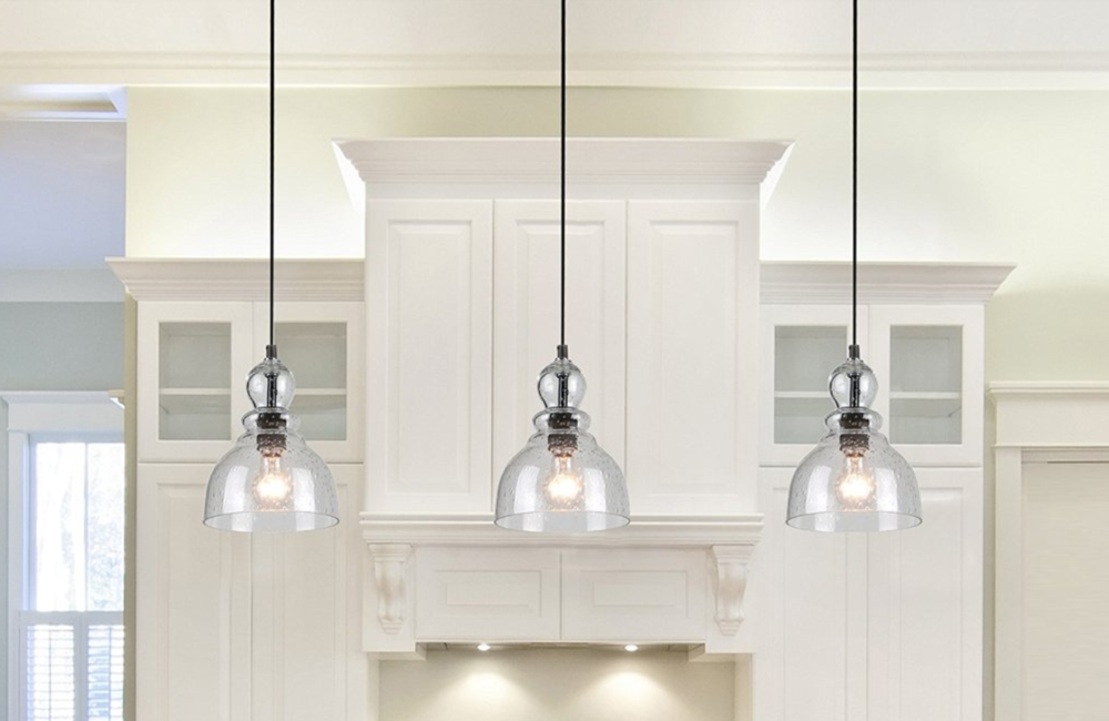 Westinghouseindustrial one light adjustable mini pendant with handblown clear seeded glass oil rubbed