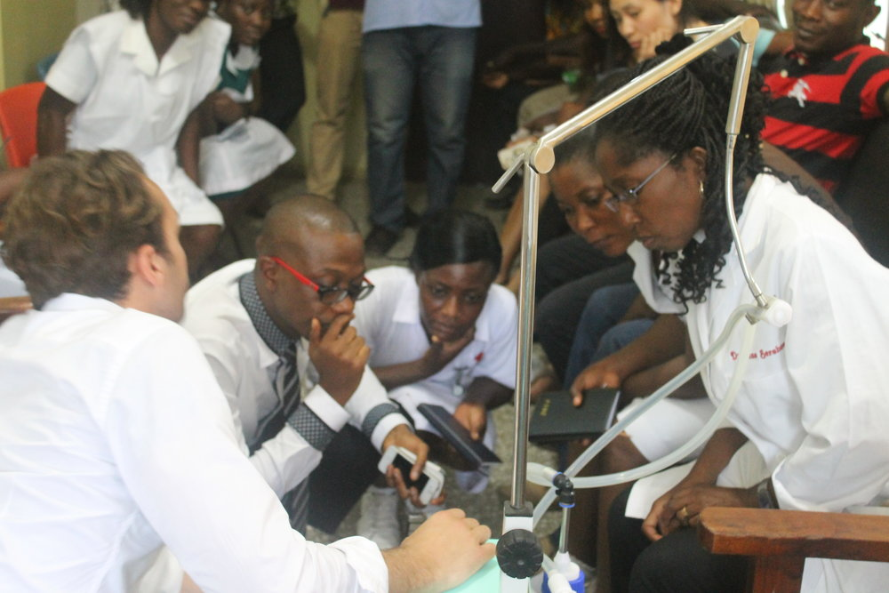 Trainers provide instruction in CPAP methods to caregivers in Ghana.