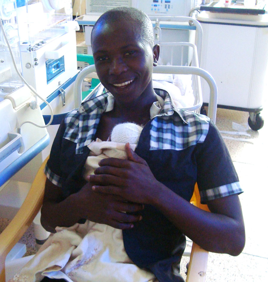 A Ugandan father enjoys some Kangaroo Care time with his new baby.