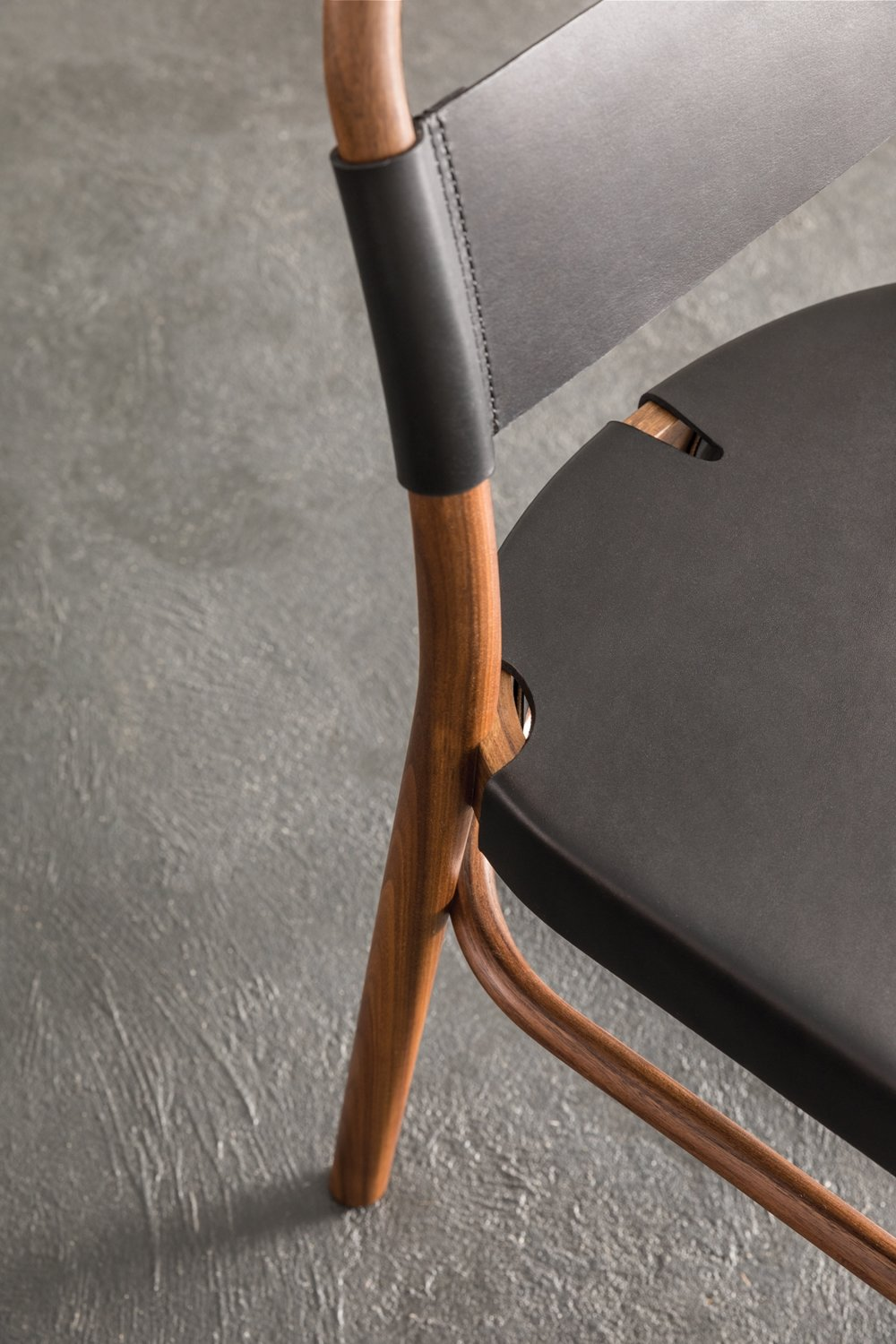 > Detail of hand-stitched leather backrest and steam-bent parts.