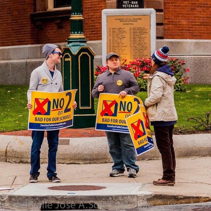 "Holding signs outside City Hall for the ""No on 2"" campaign. (Photo credit: Jose Soler)"