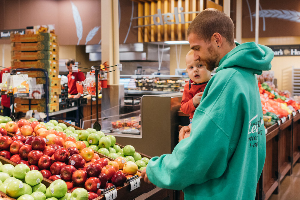 Father and Son looking at fruit