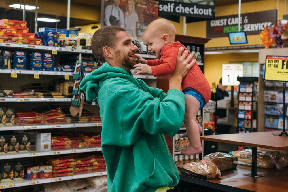 man holding smiling baby