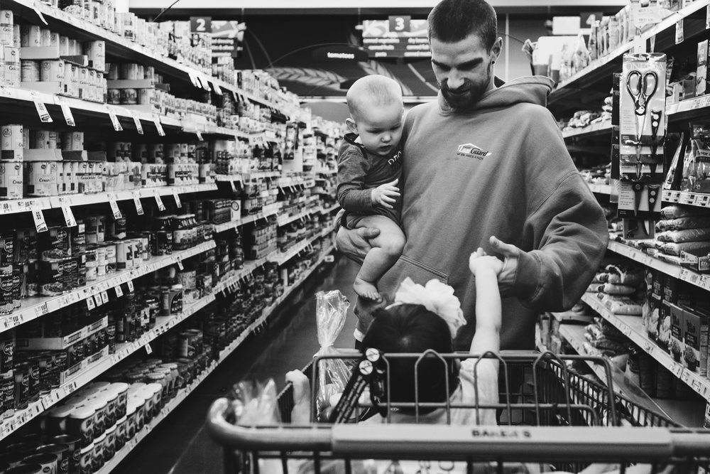 Man with kids in isle