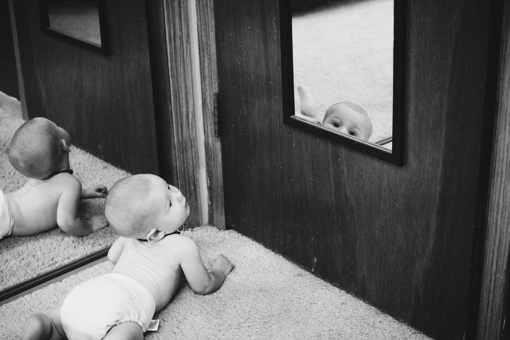 Boy looking at mirror