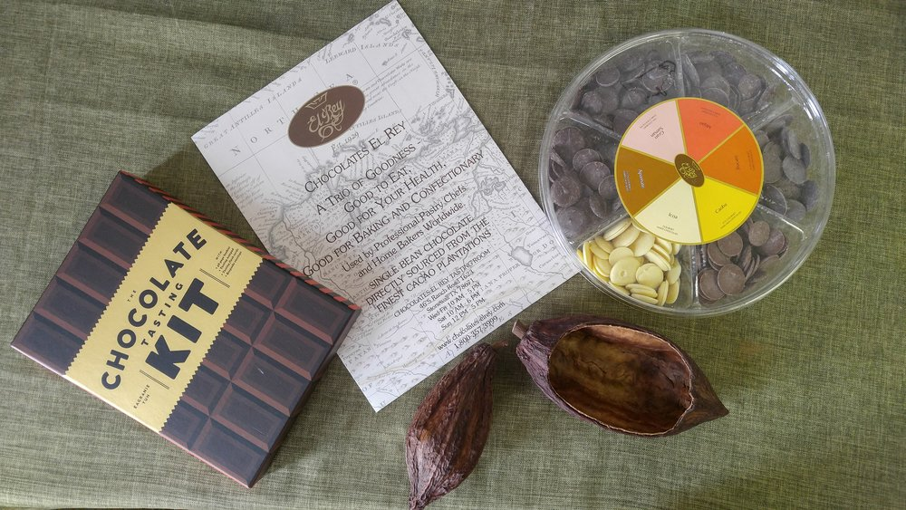 Chocolate Tasting Kit by Eagranie Yuh, Chocolates El Rey Discos Sampler pack, and cacao pods