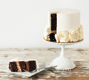 Blanc Noir: - Chocolate Cake filled with one layer of Chocolate Buttercream,and one layer of Chocolate Fudge Frosting, covered with Vanilla Swiss Meringue Buttercream.