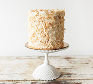 Coconut Whipped Dream - Coconut cake filled with Coconut Cream Pie Filling, covered with Coconut Whip Cream and toasted coconut flakes