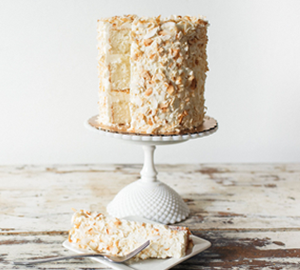 Coconut Dream:  - Coconut Cake filled with Coconut Cream Pie Filling, Coconut Cream Cheese Filling, covered with Coconut Whip Cream and toasted coconut flakes