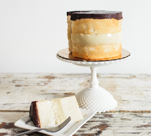 Boston Creme Pie (Cake) - Vanilla Cake filled with pastry cream and topped with our rich Chocolate ganache