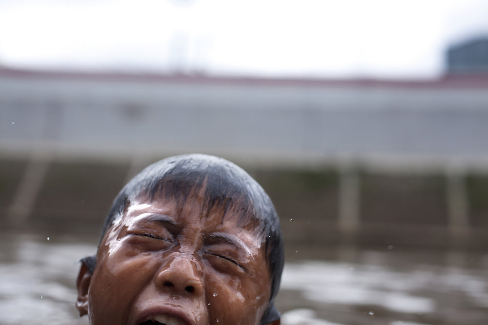 A boy swims in Central Jakarta.