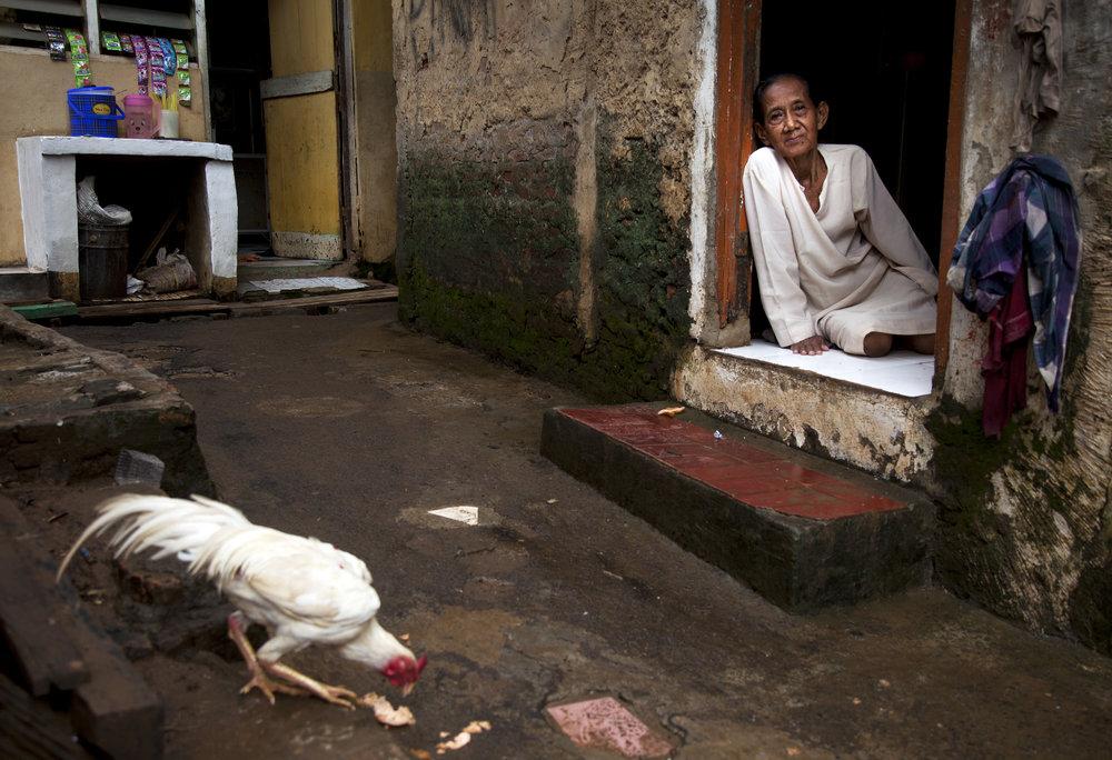 Ibu Imoh relaxes at her house at Kebon Pala.