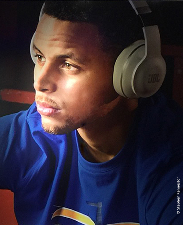Close up photo of Stephen Curry Golden State Warrior listening to music on JBL headphones