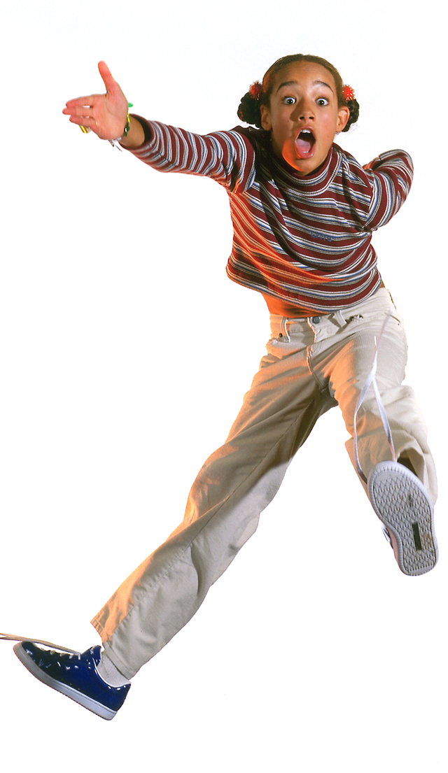 photo of a wide eyed young girl jumping with her arm outstretched wearing a Levi's stripe shirt and corduroy pants