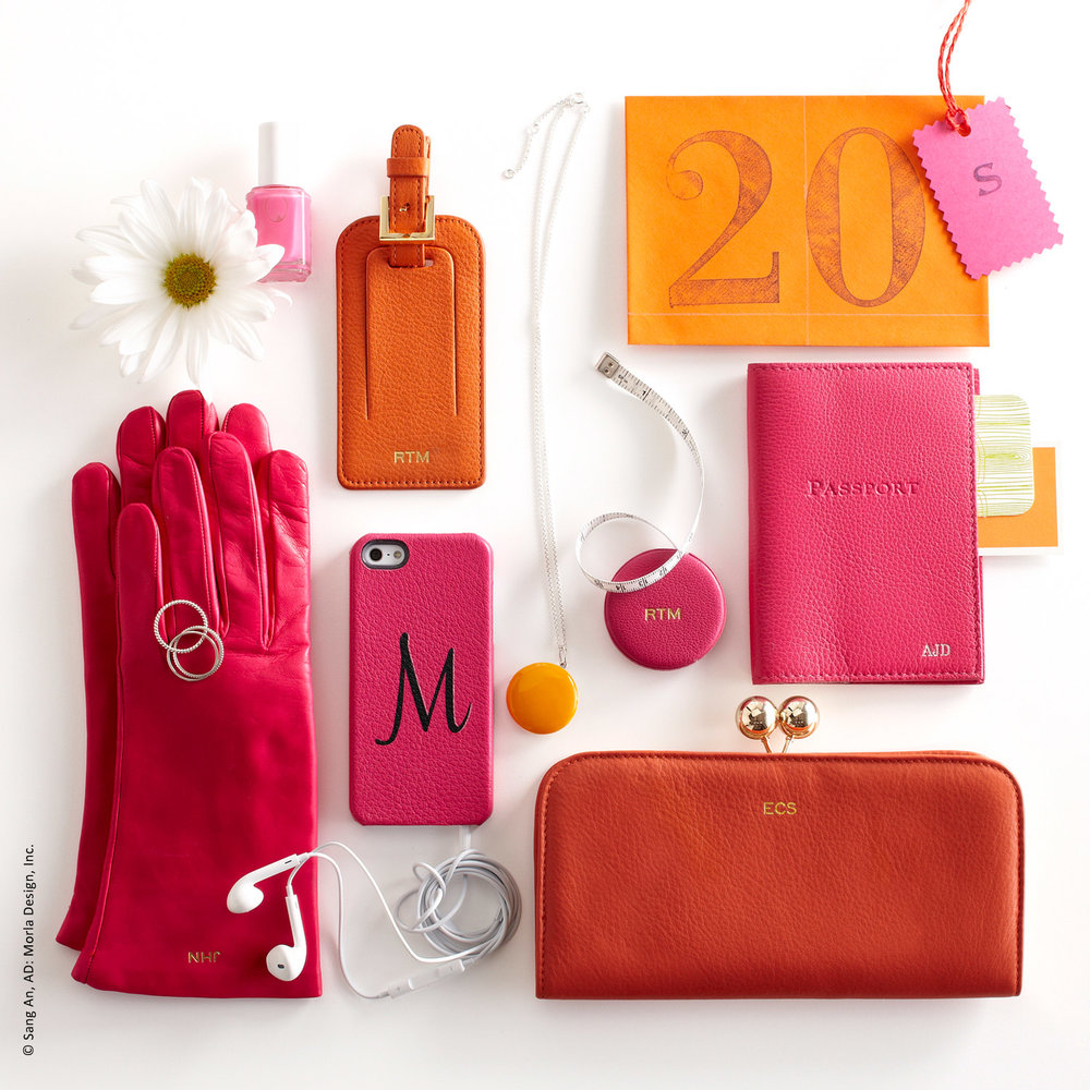 photo of graphic colorful orange and magenta e-commerce small leather goods gift ideas