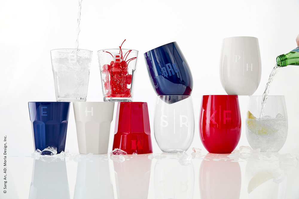photo of playful product shot of two rows of stacked colorful acrylic glasses on reflective set