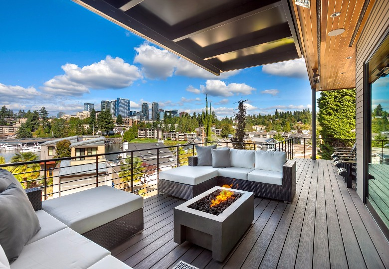 Extended outdoor living areas allow us to enjoy the outdoors all year around. Partially covered areas with lighting, fire bowl and infrared heaters provide enjoyment for colder days, so the space can be utilized throughout the changing seasons. Image credit: HD Estates
