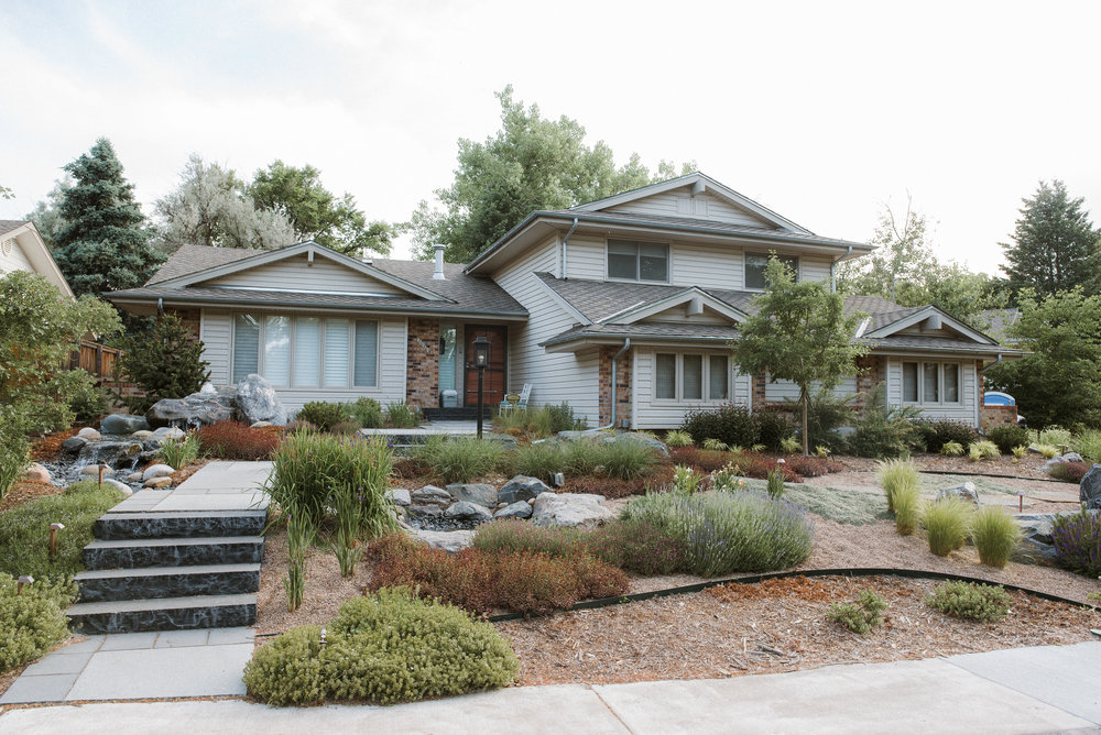 Lento   Zen-styled gardens with stone pathways, boulder fountains and a rippling brook