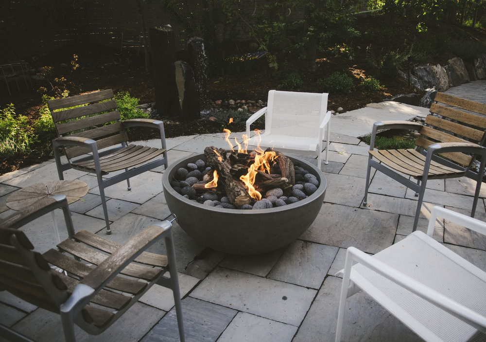Vivace   Stone patios, fire bowl, basalt column water feature, synthetic turf sports court compose this modern garden
