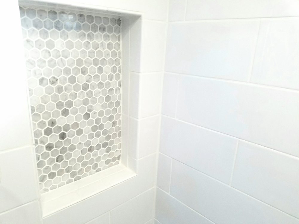 Shampoo niche with mosaic tile.jpg
