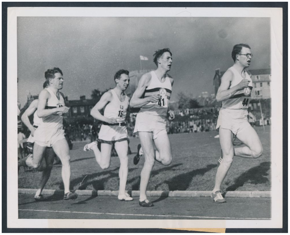 Rev. Dr. George F. Dole, #15, being led by Sir Roger Bannister, #41, in the world's first 4-minute mile.