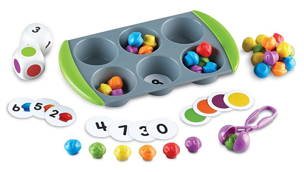 5) Mini Muffin Match Up - This game is designed to work on many early learning skills, such as counting, color and number recognition, turn-taking, and matching. It also has the additional benefit of using tweezers which strengthens the tripod grasp (grasp needed for writing).