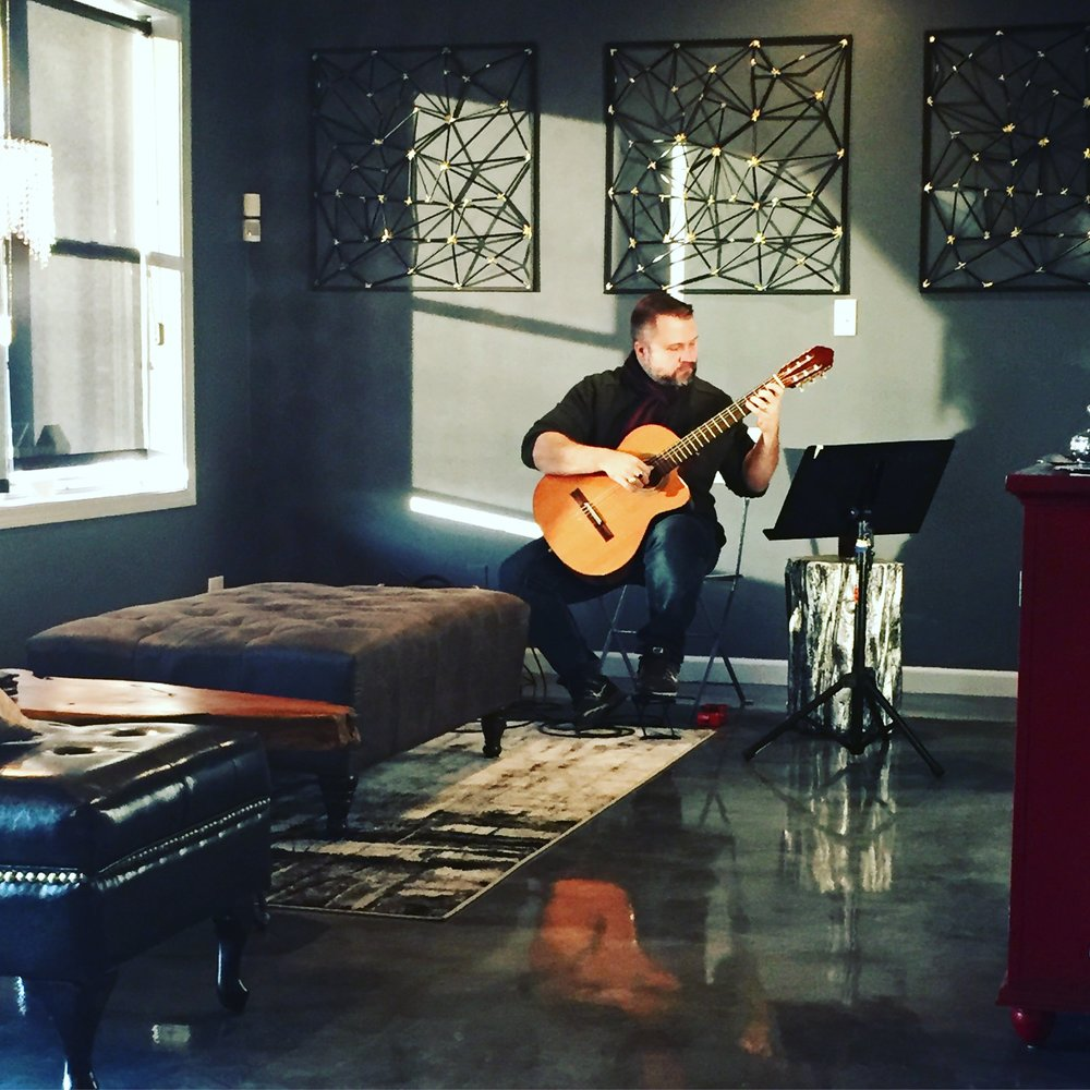 Saturday, December 8thLive Music: Classical Guitar Featuring Mike Herndon - What a wonderful event! It was such a pleasure to welcome back Mike Herndon to Coquelicot!We were thrilled so see so many of you come out to listen to his performance and support our business.