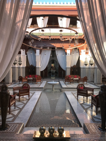 A view of the formal entry to Royal Mansour Marrakech, a hotel and spa just a short walk from the Medina. Commissioned by King Mohammed VI in 2010, he often hosts his guests in one of the 53 private riads, situated amongst the lush gardens.