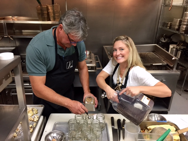 Paul and Katie prepping jars with spices for curry pickled cauliflower