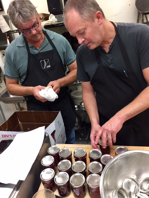 A pair of Pauls prepping the plums (say that five times fast)