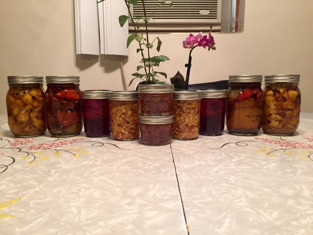 A bounty of take-home jars: curry pickled cauliflower, pickled sweet peppers, plum aigre-doux, sweet corn chow chow, peach jam