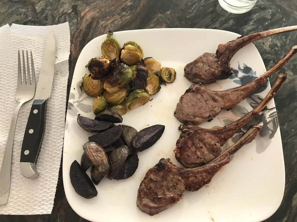 Dinner - Lamb Chops (1 red?), Roasted Brussel Sprouts with Olive Oil (1 green and 1 tsp), Roasted Purple Potatoes (1 yellow and 1 tsp), 1/2 slice of Multi-grain bread (1/2 yellow).