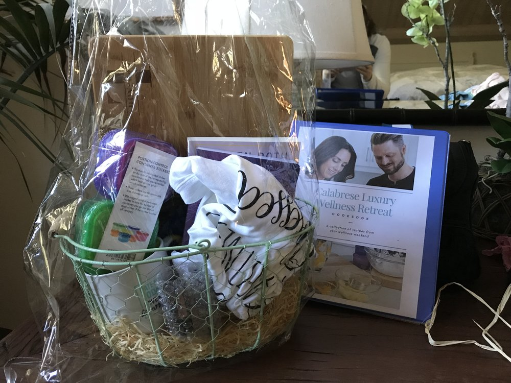 Wellness Retreat Gift Basket. Included a Cutting Board with my name on it, a couple of Essential Oils, 21 Day Fix Container Set, BeachBody Sliders, Journal, Book, T-shirt, Coffee Cup and a binder with the weekend recipes.