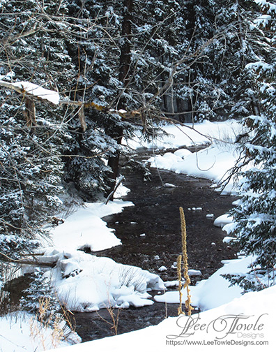Snow covered stream running through the forest, outside of Aspen is reminiscent of a winter wonderland for Christmas. This nature photography is available on a variety of print wall art and home decor items through Fine Art America.