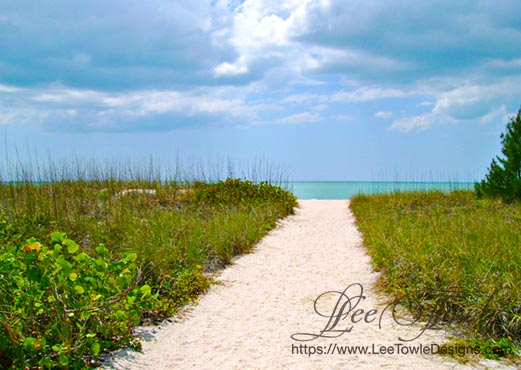 Beautiful nature photography of a path leading to a Gulf of Mexico beach with storm clouds rolling in. This nature photography is available on a variety of print wall art and home decor items through Fine Art America.