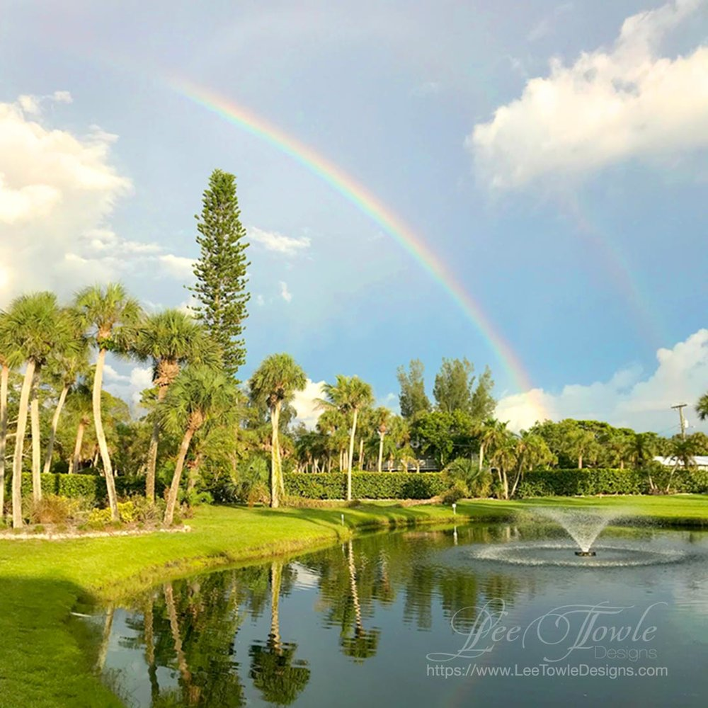 Beautiful nature photography of double rainbows in the front yard after a storm.This nature photography is available on a variety of print wall art and home decor items through Fine Art America.