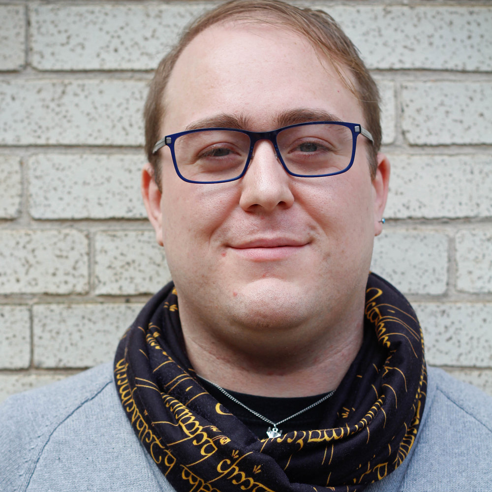 Doug Nuhfer   Doug is originally from Warren, PA but has fluttered his way down to Pittsburgh. He is a baker and woodworker and runs a vegan online bakery called  Fox Box !