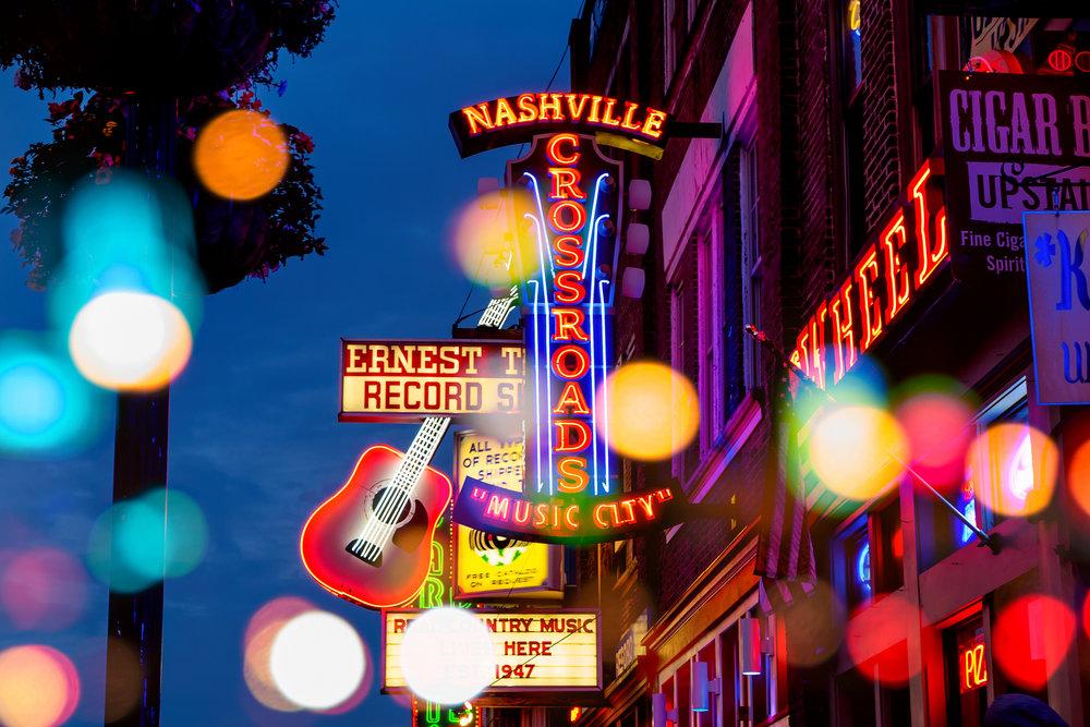 bigstock-Neon-Signs-On-Lower-Broadway-N-95586701.jpg