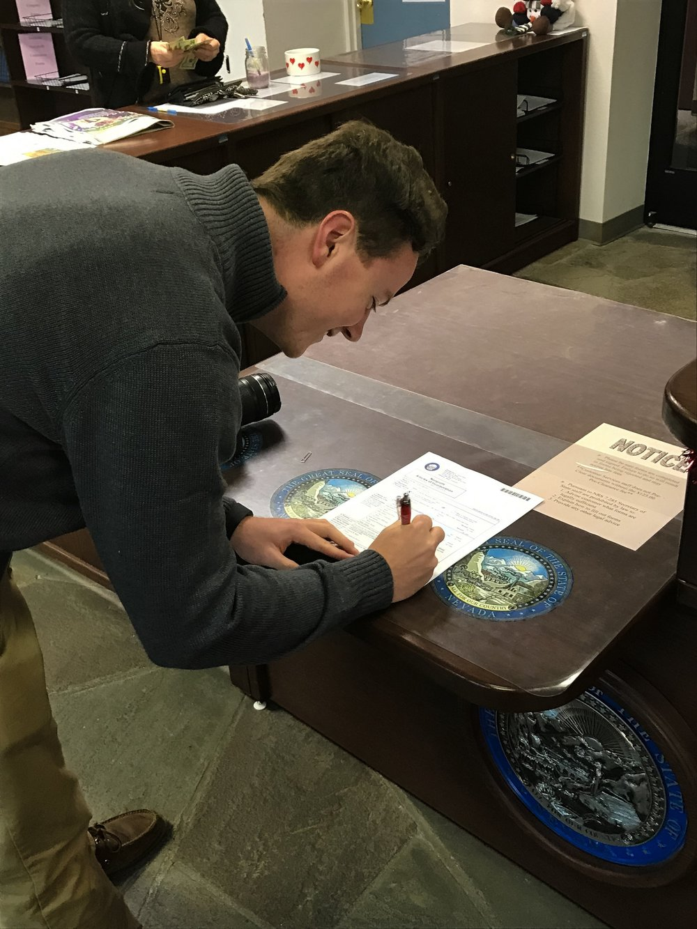Garrett signing the final paper work at the Nevada Secertary of State Office to make LEAD Green an official Nevada Non-profit 501c(3) Organization.