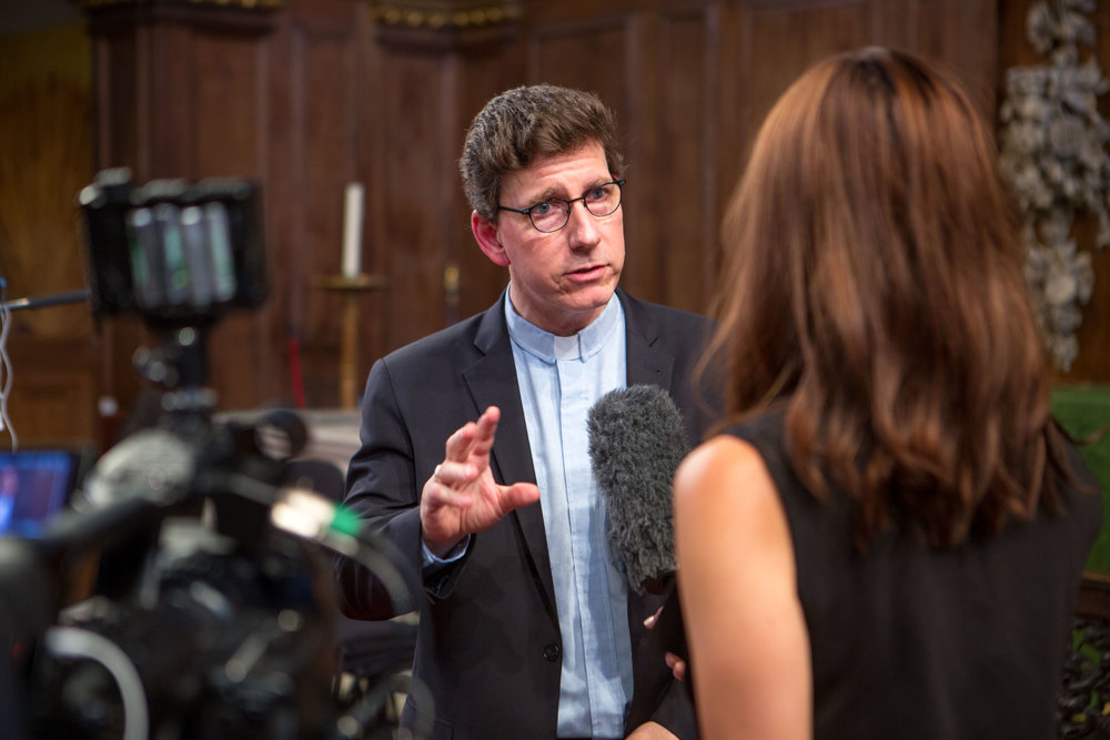Paul-Gordon Chandler during an interview with a journalist at the opening of The Key, Caravan's 2014 exhibition in London. Image courtesy of Caravan