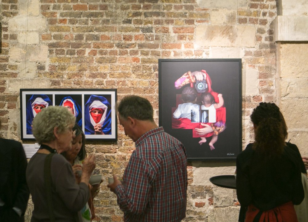 During the opening of I AM exhibition at St Martin-in-the-Fields, Trafalgar Square, London. Artwork visible is an untitled photograph by Boushra Almutawakel and Maitha Demithan's Mother (scanography). Image credit: Marc Gascoigne