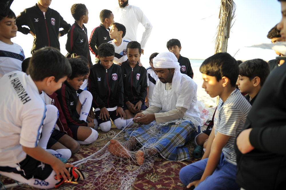Participants during a practical course with artisans in the fishing trade. Image courtesy of Sharjah Art Foundation.