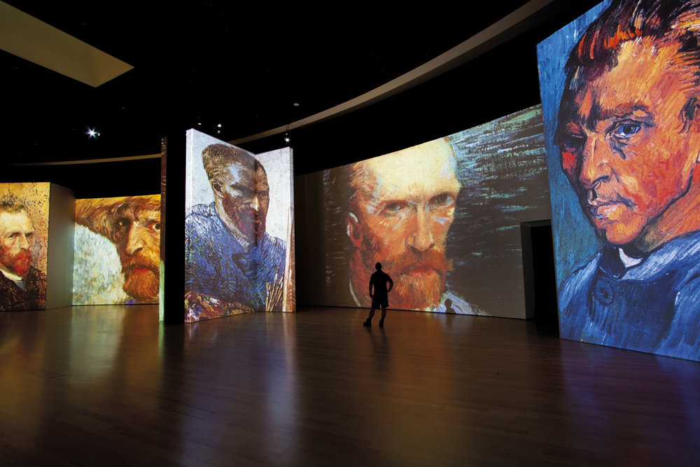 A collection of Van Gogh's many self portraits seen as larger than life in the multi-sensory exhibition of images and sound.