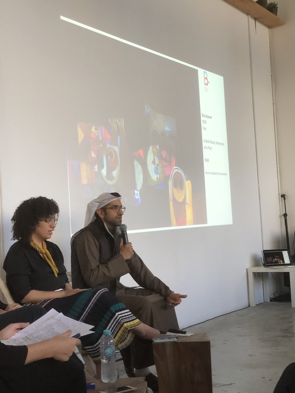 Sultan Sooud Al Qassemi reveals his latest acquisition to audiences at a panel discussion in Alserkal Avenue. The image is Dia Azzawi's A Wolf Howls: Memories of a Poet (1968)