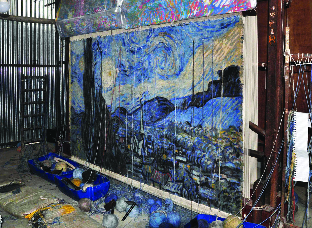 The Starry Night as rendered in hand-woven Tibetan style carpet in its finishing stages. The textile creation will be sold during a silent auction as part of Dubai Art Season. Image courtesy of Samovar Carpets.