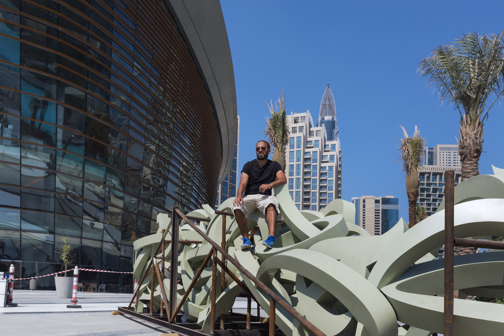 eL Seed's calligraphic sculpture - a 30 metre piece weighing 3.5 tonnes - is installed in the piazza outside of Dubai Opera. Image by Christina Dimitrova. Courtesy eL Seed Studio.